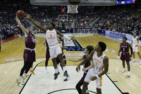 Mar 22, 2019; Columbus, OH, USA; Colgate Raiders forward Will Rayman (10) collects a rebound in front of Tennessee Volunteers guard Admiral Schofield (5) in the second half in the first round of the 2019 NCAA Tournament at Nationwide Arena. Mandatory Credit: Rick Osentoski-USA TODAY Sports