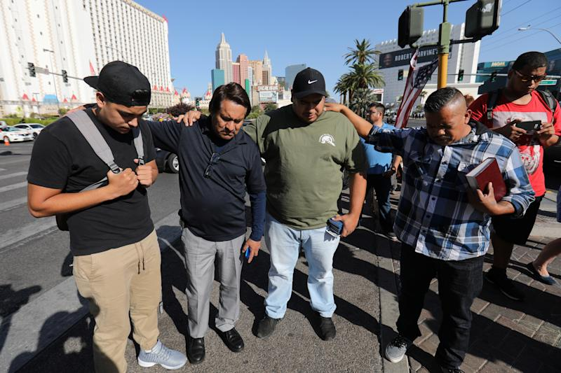 A group of men pray at a makeshift memorial in the middle of Las Vegas Boulevard following the mass shooting in Las Vegas, Nevada, U.S., October 4, 2017.  (Mike Blake / Reuters)
