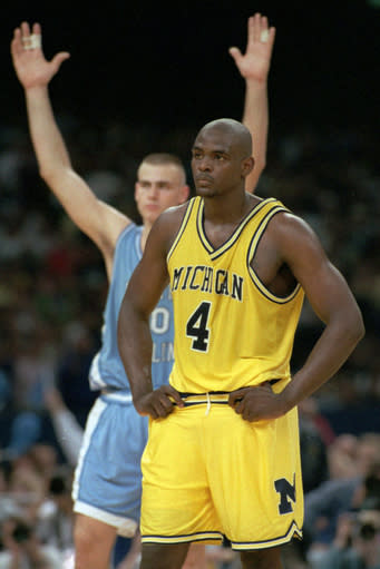 FILE - In this April 5, 1993, file photo, Michigan's Chris Webber (4) stands by as North Carolina's Eric Montross celebrates during North Carolina's technical foul shots in the final seconds of the NCAA Final Four championship game at the Superdome in New Orleans. Webber called a time out Michigan did not have, and Michigan was charged with a technical foul and lost possession of the ball. Donald Williams made all four free throws and North Carolina won the national title 77-71. (AP Photo/Susan Ragan, File)