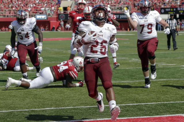 FILE - In this Sept. 15, 2018, file photo, Troy running back B.J. Smith (26) runs into the end zone past Nebraska defensive lineman Khalil Davis (94) during the first half of an NCAA college football game in Lincoln, Neb. Smith was named Sun Belt Conference preseason Offensive Player of the Year after rushing for 1,186 yards and 13 touchdowns in 2018. (AP Photo/Nati Harnik, File)