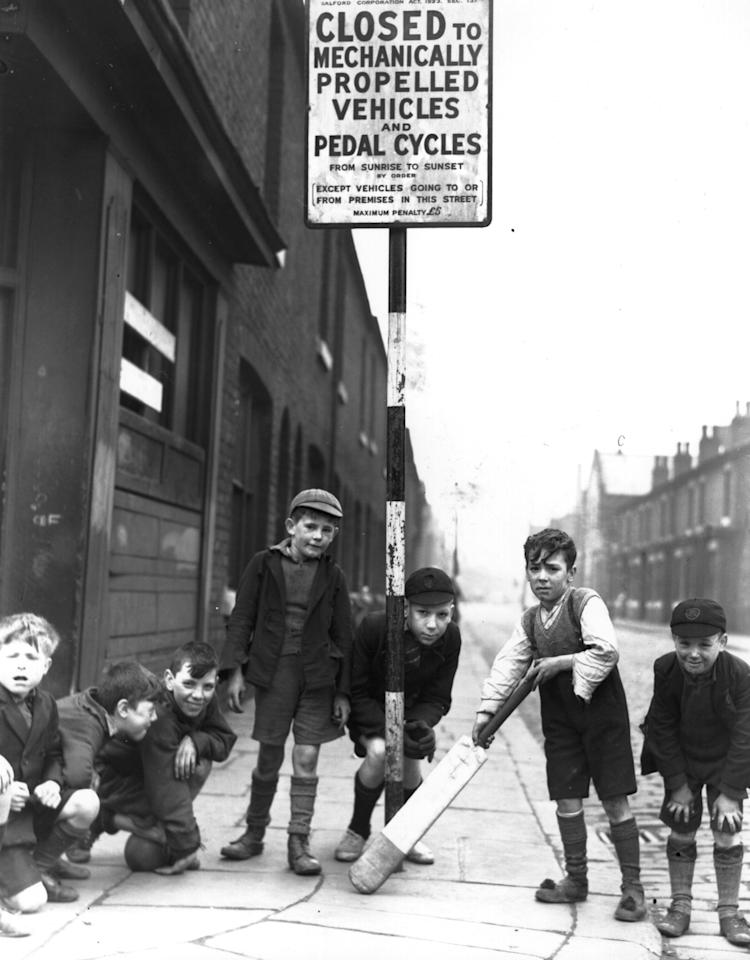 16th April 1938:  Children playing cricket in Salford in a street that has been closed to vehicular traffic.  (Photo by Fox Photos/Getty Images)