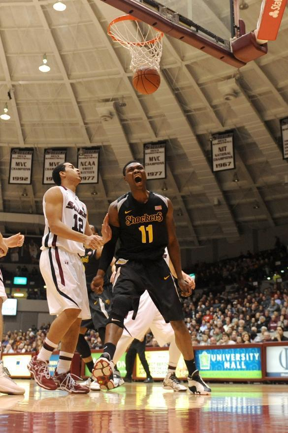 Wichita State's Cleanthony (11) yells after scoring as Southern Illinois' Marcus Fillyaw watches the ball drop during the first period of a Missouri Valley Conference NCAA college basketball game in Carbondale, Ill., Thursday, Jan. 2, 2014. (AP Photo/Stephen Lance Dennee)