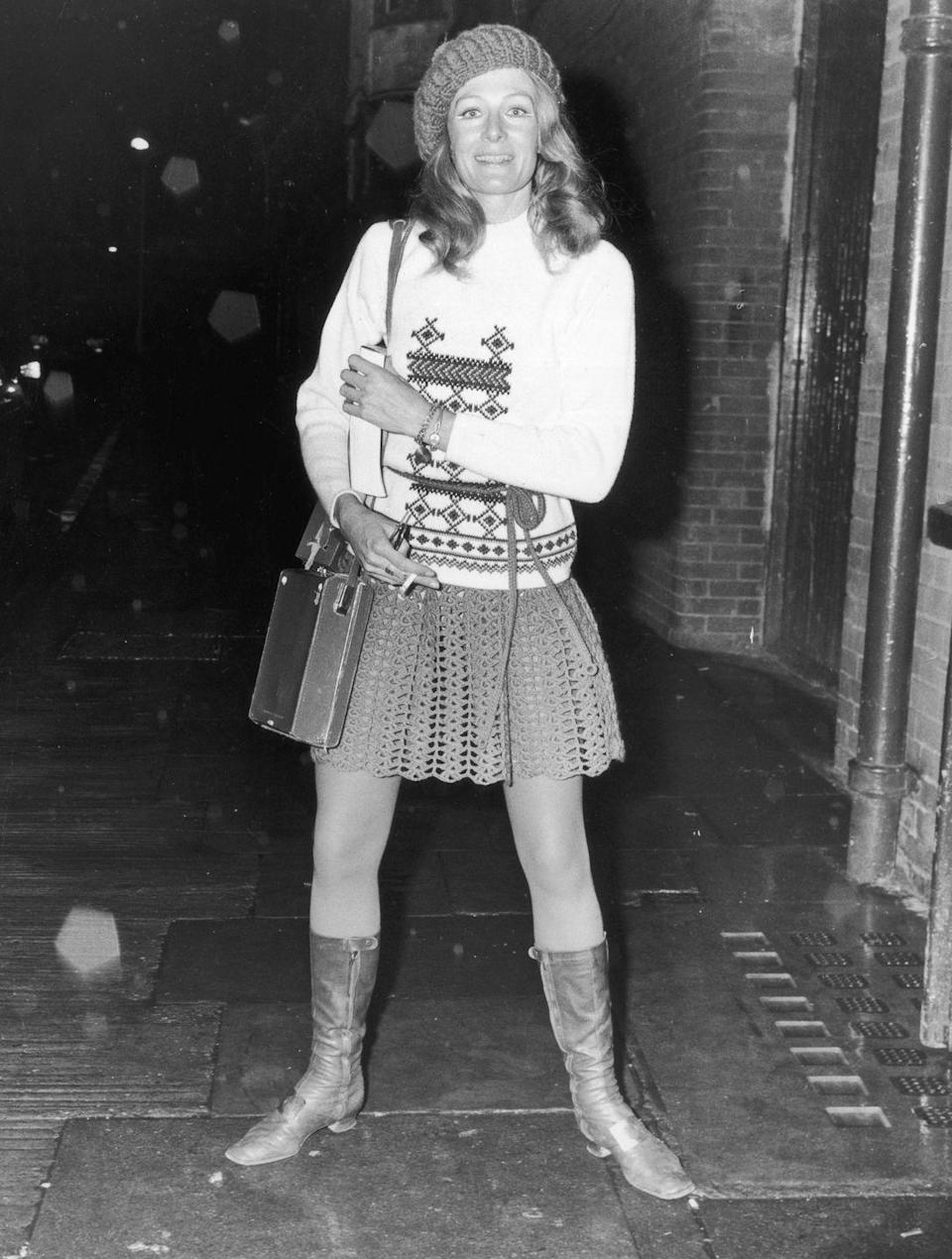 <p>Vanessa Redgrave dressed up her calf-high boots with a miniskirt and sweater, accessorizing with a cute beret.</p>