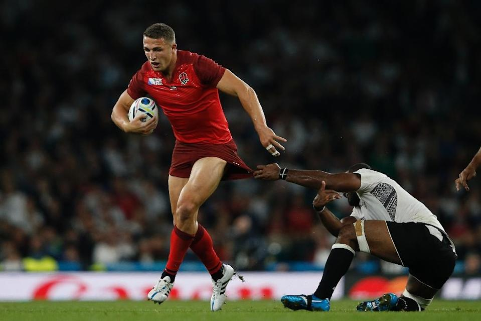 England coach Stuart Lancaster has hit selection controversy by bringing rugby league convert Sam Burgess (L) into the team with precious little international experience (AFP Photo/Adrian Dennis)