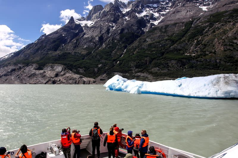 FILE PHOTO: A block of ice broken off from Grey glacier floats at the Torres del Paine National Park in Chile