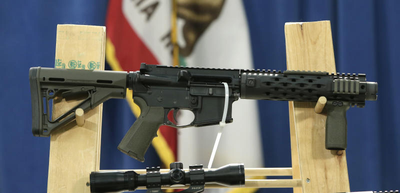 """A homemade fully automatic rifle, confiscated by the Department of Justice, is displayed at a news conference held by Sen. Kevin de Leon where he unveiled legislation dealing with so called """"ghost guns,"""" at the Capitol in Sacramento, Calif., Monday, Jan. 13, 2014. Under de Leon's proposed legislation, SB808 would allow the manufacture or assembly of homemade weapons, but require the makers to first apply to the state Department of Justice for a serial number that would be given only after the applicants undergo a background check. De Leon plans to amend the bill to also require that guns contain permanent pieces of metal that could be detected by X-ray machines and metal detectors. .(AP Photo/Rich Pedroncelli)"""