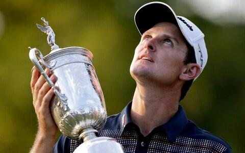 Justin Rose, of England, poses with the trophy after winning the U.S. Open golf tournament at Merion Golf Club, Sunday, June 16, 2013