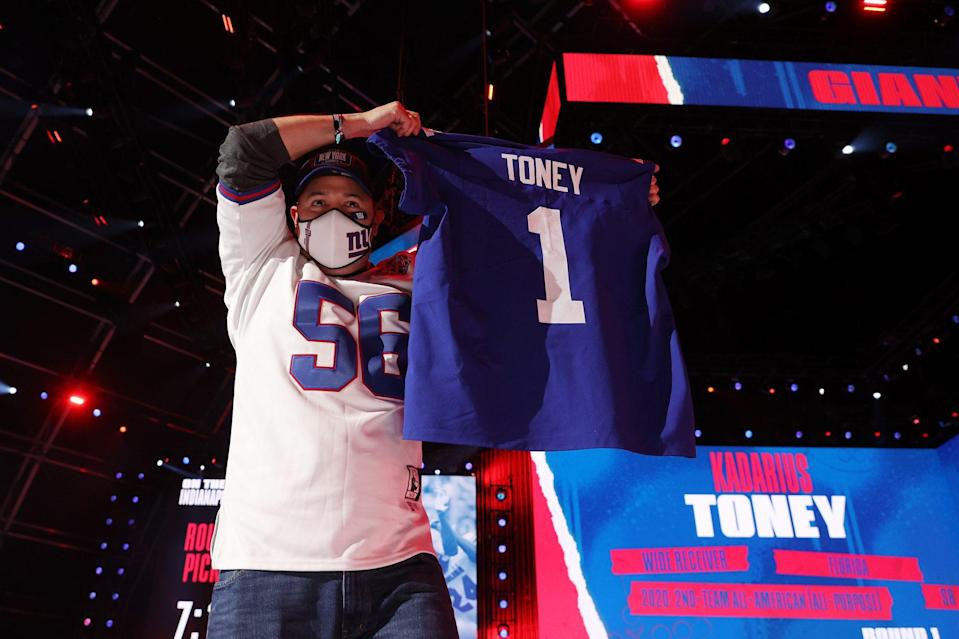 <p>Florida's Kadarius Toney, a wide receiver, is now a New York Giant, as a fan proudly held up the athlete's new jersey.</p>