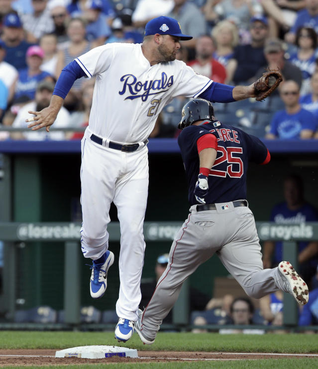 Boston Red Sox's Steve Pearce (25) beats out an infield hit past Kansas City Royals first baseman Lucas Duda (21) during the first inning of a baseball game at Kauffman Stadium in Kansas City, Mo., Friday, July 6, 2018. (AP Photo/Orlin Wagner)