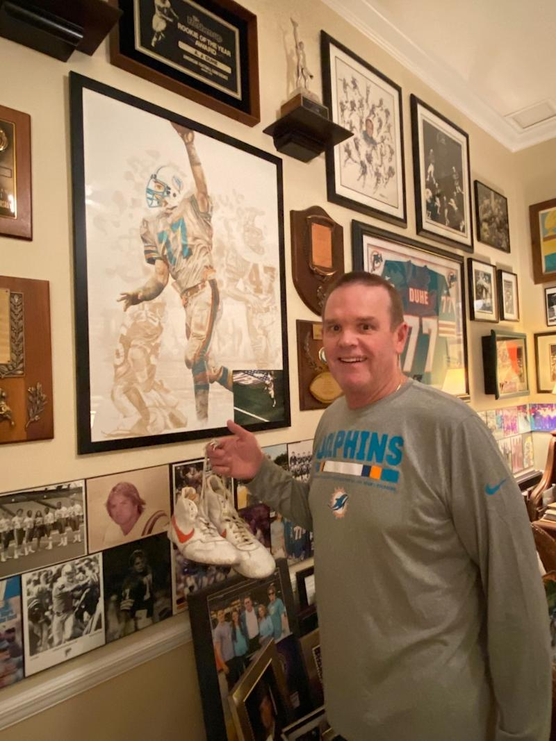 A.J. Duhe in his trophy room with the shoes from his famous game against the Jets. (Photo courtesy of Duhe)