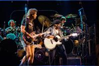 <p>Bob Dylan playing guitar with the Grateful Dead on July 12, 1987.</p>