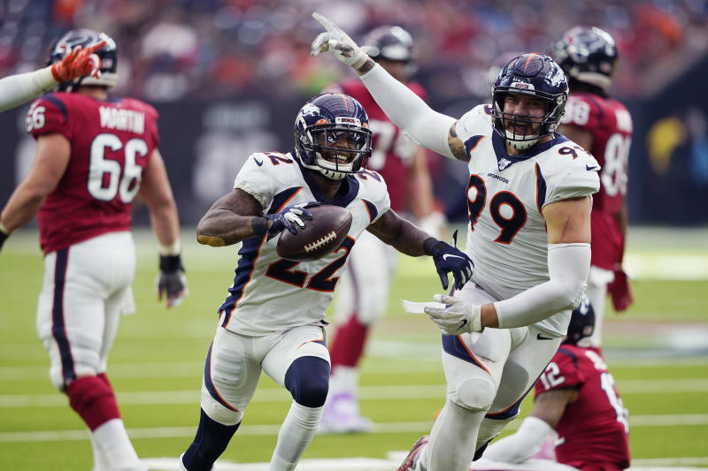 Denver Broncos strong safety Kareem Jackson (22) celebrates his interception against the Houston Texans during the second half of an NFL football game Sunday, Dec. 8, 2019, in Houston. (AP Photo/David J. Phillip)