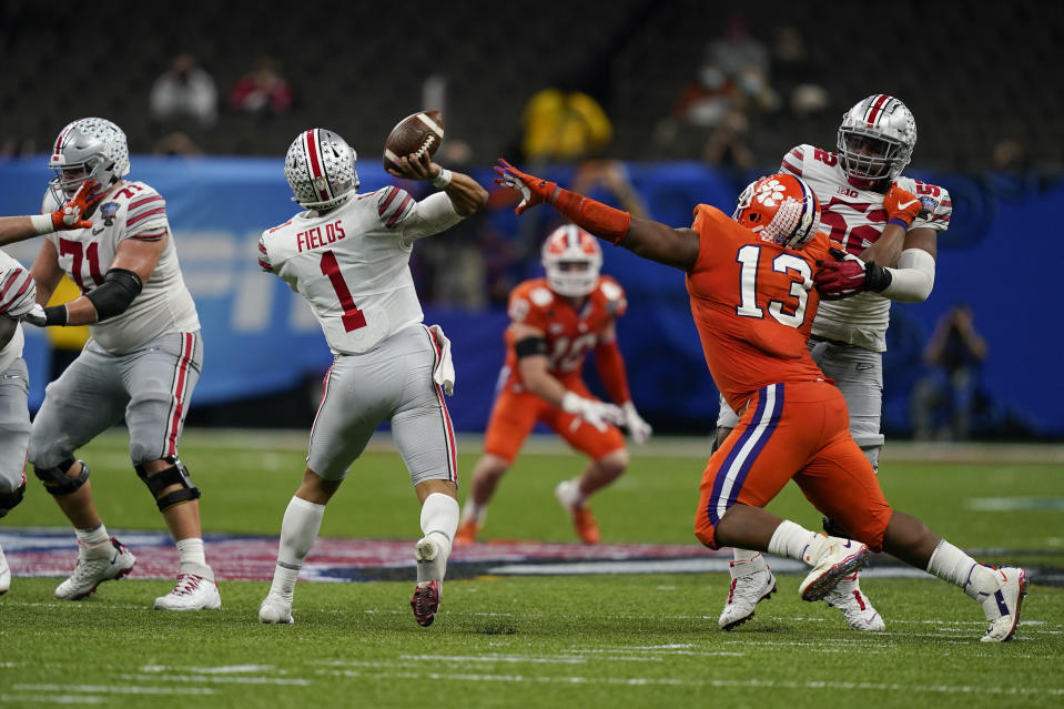 Ohio State quarterback Justin Fields throws for a touchdown against Clemson during the second half of the Sugar Bowl NCAA college football game Friday, Jan. 1, 2021, in New Orleans. (AP Photo/Gerald Herbert)