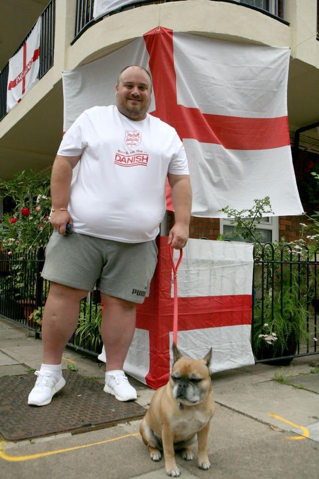 Chris Dowse and his eight-year-old French bulldog Tinkerbell on the Kirby Estate in Bermondsey where residents are showing their support for England