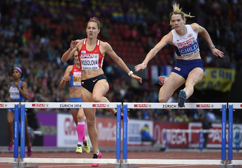 Great Britain's Eilidh Child (R) jumps on her way to win the Women's 400m Hurdles final ahead of fourth-placed Czech Republic's Denisa Rosolova (L) during the European Athletics Championships at the Letzigrund stadium in Zurich on August 16, 2014 (AFP Photo/Fabrice Coffrini )