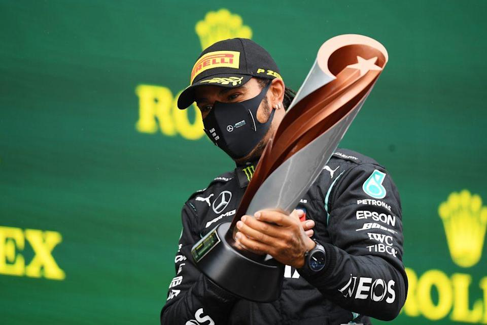 Race winner Lewis Hamilton of Great Britain and Mercedes GP celebrates winning a 7th F1 World Drivers Championship on the podium during the F1 Grand Prix of Turkey at Intercity Istanbul Park on November 15, 2020 in Istanbul, Turkey. (Photo by Clive Mason/Getty Images)