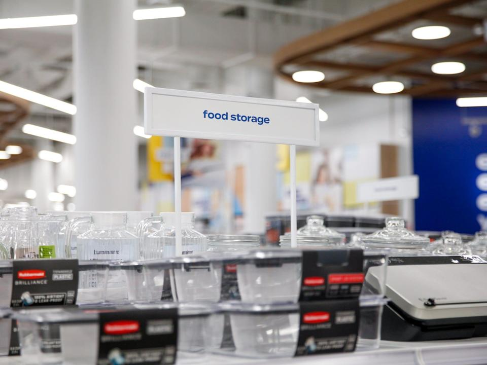"""a sign that says """"food storage"""" with tupperware under it"""