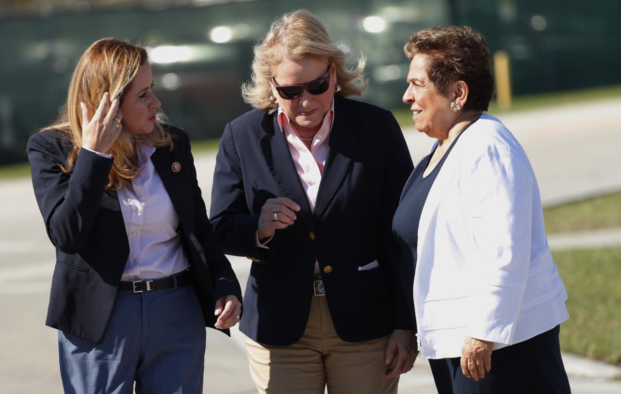Rep. Debbie Mucarsel-Powell, D-Fla., left, Rep. Sylvia Garcia, D-Texas, center, and Rep. Donna Shalala talk after a tour the Homestead Temporary Shelter for Unaccompanied Children, Tuesday, Feb. 19, 2019, in Homestead, Fla. (AP Photo/Wilfredo Lee)