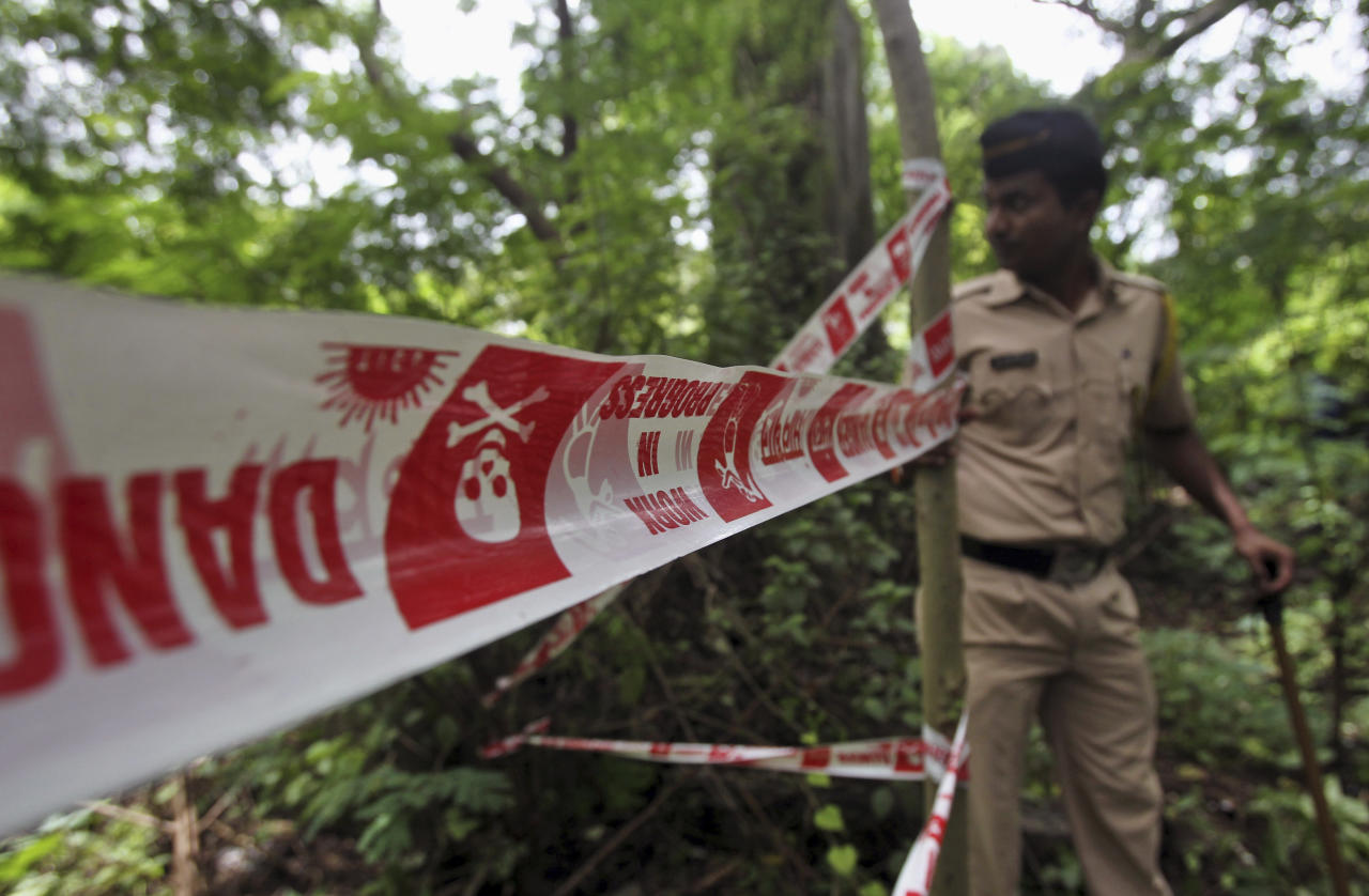 An Indian policeman inspects the site where a 22-year-old woman was gang raped in Mahalaxmi area in Mumbai India, Friday, Aug. 23, 2013. The young woman photojournalist was gang raped while her male colleague was tied up and beaten in India's business hub of Mumbai, police said Friday. The case was reminiscent of the December gang rape and death of a young university student in the Indian capital that shocked the country. (AP Photo/Rafiq Maqbool)