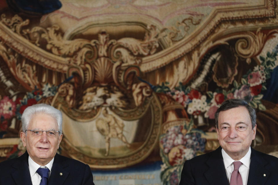 Italian President Sergio Mattarella and Prime Minister Mario Draghi speak after the swearing-in ceremony, at the Quirinale Presidential Palace in Rome, Saturday, Feb. 13, 2021. Mario Draghi, credited with largely saving the euro currency, has formally taken the helm of Italy, focused on guiding the country through the pandemic and reviving its economy. Premier Draghi and his Cabinet ministers were sworn into office Saturday at the Quirinal presidential palace in front of President Sergio Mattarella. (Guglielmo Mangiapane/Pool photo via AP)