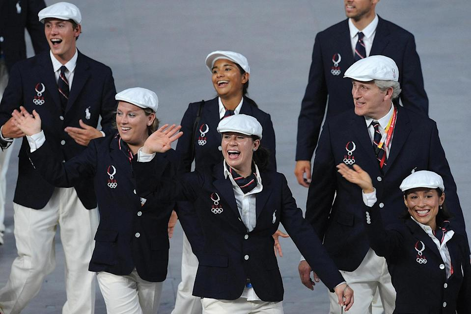 <p>The look included the classic Americana charm of Ralph Lauren with cream trousers, single-breasted navy blazers with the Olympic logo and red, white and blue neckties or scarves. </p>