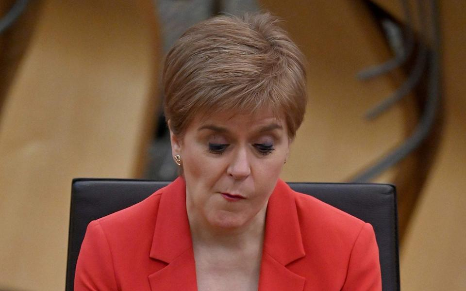 Nicola Sturgeon appeared to contradict Jeane Freeman about when the roll-out would be completed - AFP