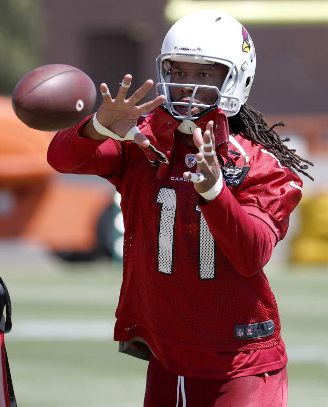 Arizona Cardinals NFL football player Larry Fitzgerald (11) runs drills during a voluntary team activity Tuesday, April 17, 2018, at the Cardinals' training facility in Tempe, Ariz.(AP Photo/Matt York)