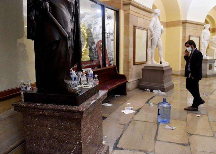 Damage is seen inside the US Capitol building early on January 7, 2020 in Washington, DC, after supporters of US President Donald Trump breached security and entered the building during a session of Congress