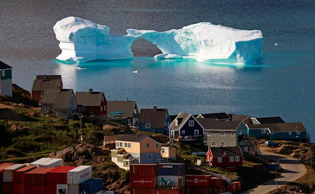 <p>An iceberg floats near a harbor in the town of Kulusuk, east Greenland August 1, 2009. (Bob Strong/Reuters) </p>