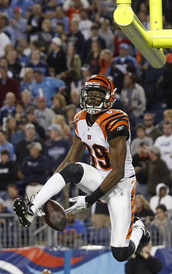 Cincinnati Bengals wide receiver Jerome Simpson celebrates after scoring a touchdown on a 15-yard pass play in the third quarter of an NFL football game against the Tennessee Titans on Sunday, Nov. 6, 2011, in Nashville, Tenn. (AP Photo/Wade Payne)