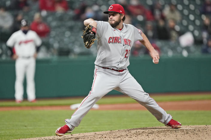Cincinnati Reds starting pitcher Wade Miley delivers in the sixth inning of a baseball game against the Cleveland Indians, Friday, May 7, 2021, in Cleveland. (AP Photo/Tony Dejak)