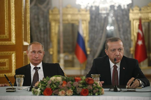 <p>Turkey's President Recep Tayyip Erdogan, right and Russian President Vladimir Putin, left, hold a news conference following their meeting in Istanbul, Monday, Oct. 10, 2016. Putin and Erdogan voiced support for the construction of a gas pipeline from Russia to Turkey, called Turkish Stream, a project that was suspended amid tensions between the two countries. The pipeline would carry Russian natural gas to Turkey and onto European Union countries. (AP Photo/Emrah Gurel) </p>