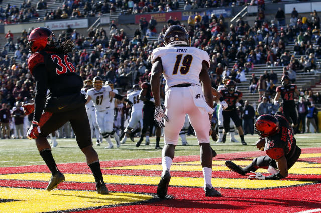 San Diego State cornerback Luq Barcoo (16) intercepts a pass intended for Central Michigan wide receiver Tyrone Scott (19) in the end zone during the first half of the New Mexico Bowl NCAA college football game on Saturday, Dec. 21, 2019 in Albuquerque, N.M. (AP Photo/Andres Leighton)