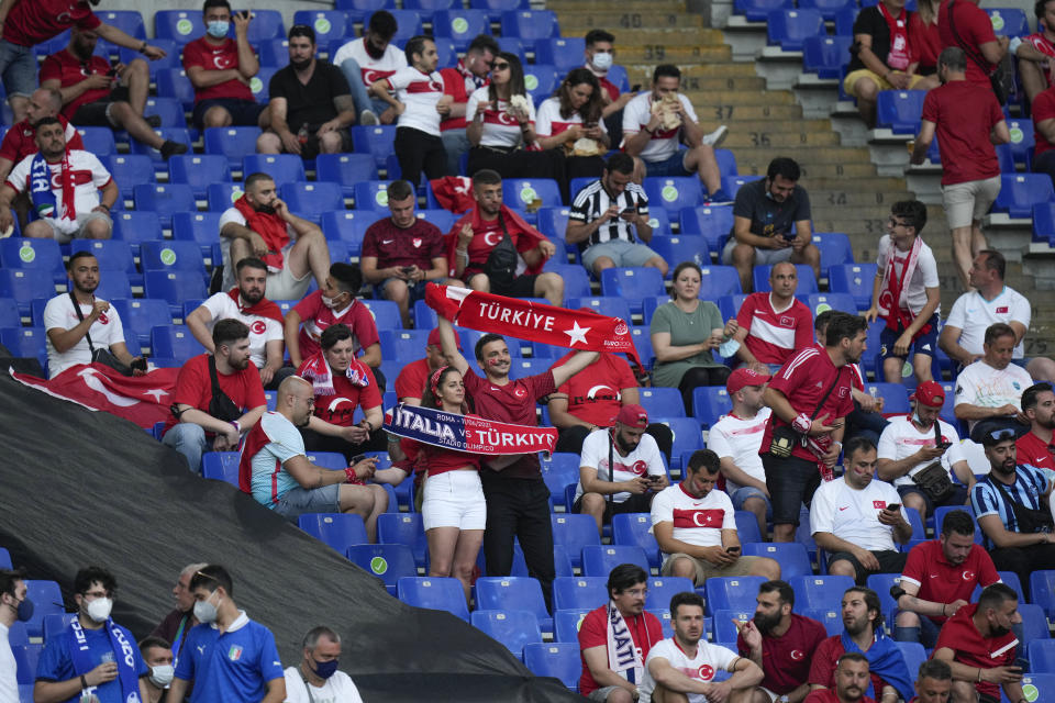 Turkish fans wait for the kick-off of the Euro 2020, group A soccer match between Italy and Turkey, at the Rome Olympic stadium, Friday, June 11, 2021. (AP Photo/Alessandra Tarantino, Pool)
