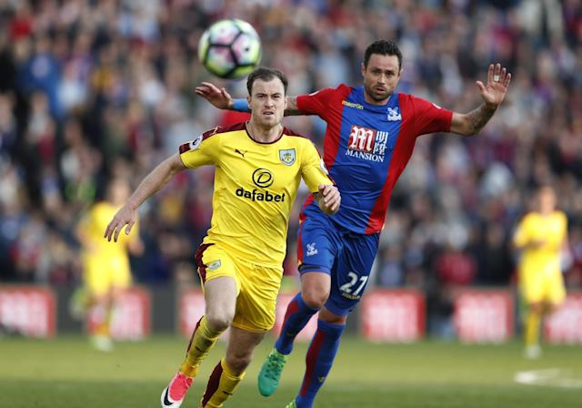 <p>Burnley's Ashley Barnes in action with Crystal Palace's Damien Delaney </p>