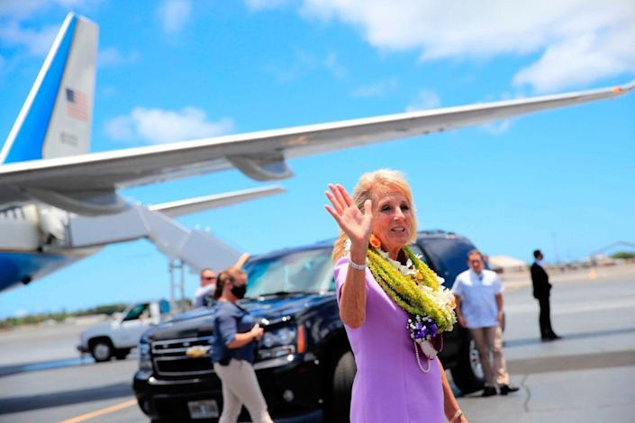 First lady Jill Biden waves to the media on the tarmac after arriving at Joint Base Pearl Harbor-Hickam, Hawaii, Saturday, July 24, 2021. - Credit: AP