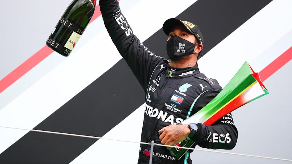 Lewis Hamilton, pictured here celebrating his record-breaking 92nd race win in Formula One.