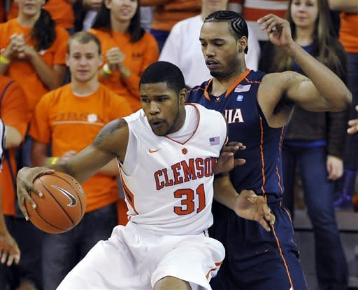 Clemson's Devin Booker (31) works against Virginia's Mike Scott during the first half of an NCAA college basketball game Tuesday, Feb. 14, 2012, in Clemson, S.C. (AP Photo/Rainier Ehrhardt)