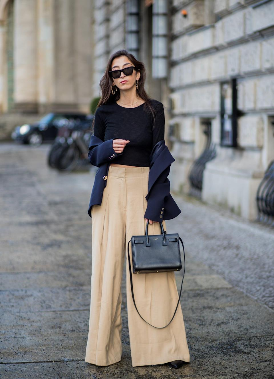 <p>Since wide-leg pants have so much wow factor, you don't need anything but a simple t-shirt to top things off.</p>