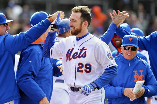 New York Mets first baseman Ike Davis (29) celebrates with his teammates after hitting a walk-off grand slam in the ninth inning of a baseball game against the Cincinnati Reds at Citi Field, Saturday, April 5, 2014, in New York. The Mets won 6-3. (AP Photo/John Minchillo)
