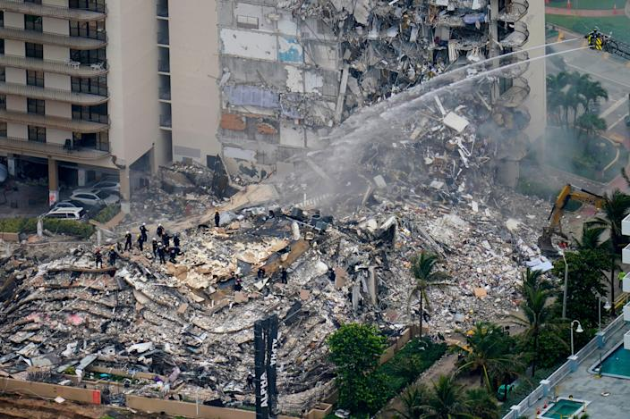 Rescue workers sift through rubble at the Champlain Towers South Condo June 25 in Surfside, Fla.