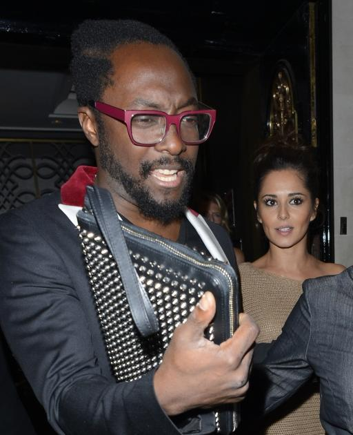 Will.i.am and Cheryl Cole are spotted leaving Scotts in London, Aug. 11, 2012 -- Getty Images