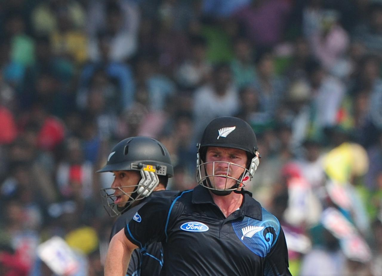 New Zealand cricketers Ross Taylor (L) and Colin Munro run between the wickets during the third One-Day International (ODI) cricket match between Bangladesh and New Zealand at Khan Jahan Ali Stadium in Fatullah, on the outskirts of Dhaka on November 3, 2013.  AFP PHOTO/ Munir uz ZAMAN        (Photo credit should read MUNIR UZ ZAMAN/AFP/Getty Images)
