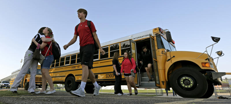 High school students from West, Texas, arrive for classes at a temporary facility provided by the Connally Independent School District Monday, April 22, 2013, in Waco, Texas. West students returned back  to class today after a massive explosion at the West Fertilizer Co. five days ago damaged three of West's four schools, killed 14 people and injured more than 160 others. (AP Photo/Charlie Riedel)