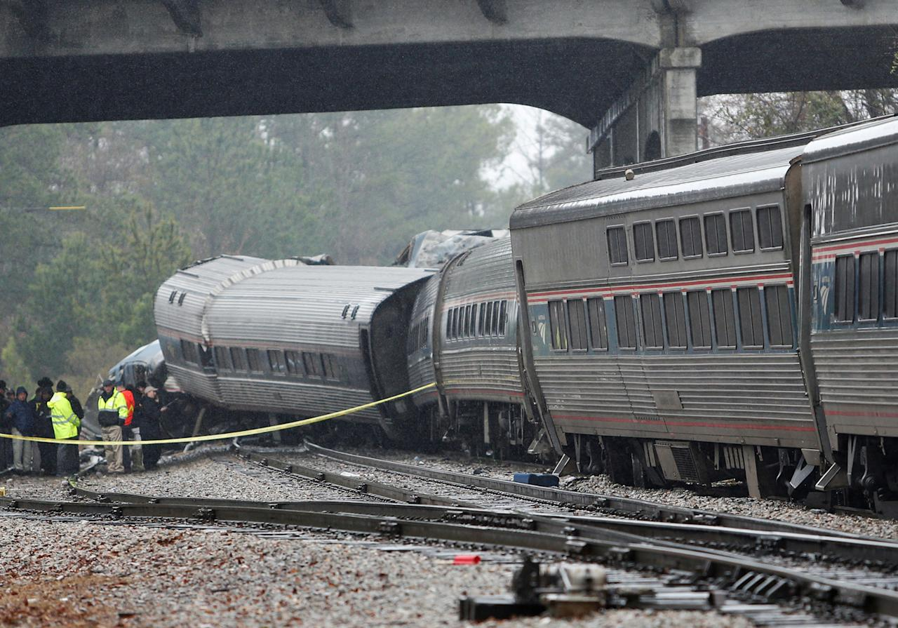 <p>Emergency responders are at the scene after an Amtrak passenger train collided with a freight train and derailed in Cayce, South Carolina, Feb. 4, 2018. (Photo: Randall Hil/Reuters) </p>