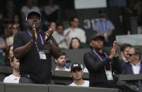 The parents of Coco Gauff of the US applaud during the women's singles second round match against Russia's Elena Vesnina on day four of the Wimbledon Tennis Championships in London, Thursday July 1, 2021. (AP Photo/Alberto Pezzali)