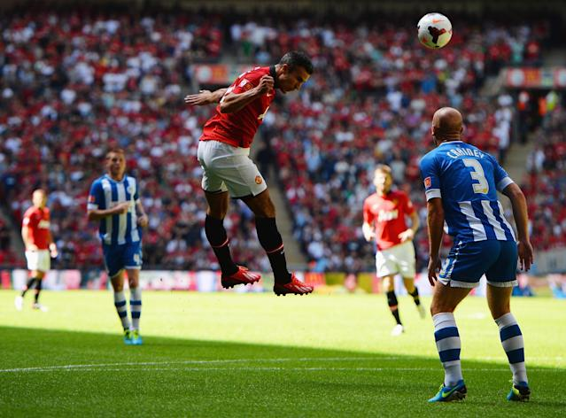 LONDON, ENGLAND - AUGUST 11: Robin van Persie of Manchester United heads in the opening goal during the FA Community Shield match between Manchester United and Wigan Athletic at Wembley Stadium on August 11, 2013 in London, England. (Photo by Laurence Griffiths/Getty Images)