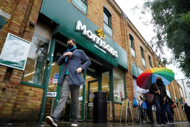 Morrisons chairman Andrew Higginson said the board had approved the offer, which would now go to shareholders for the final say (AFP/Niklas HALLE'N)