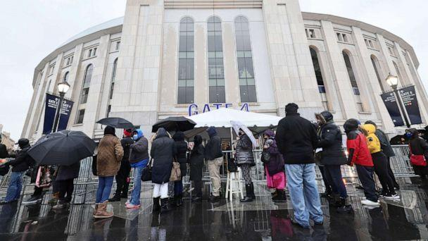 PHOTO: People wait in line to enter a coronavirus (COVID-19) vaccination site at Yankee Stadium on Feb. 5, 2021 in the Bronx, New York. (Michael M. Santiago/Getty Images)