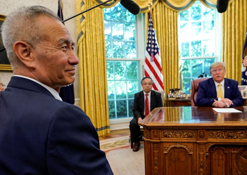 China's Vice Premier Liu He looks on during a meeting with U.S. President Donald Trump in the Oval Office of the White House in Washington, U.S., October 11, 2019. REUTERS/Yuri Gripas TPX IMAGES OF THE DAY